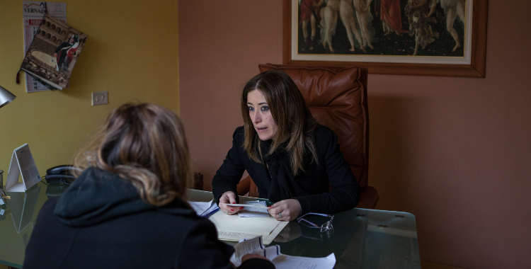 Stefania Salzillo talks with a client in her offices in Aversa